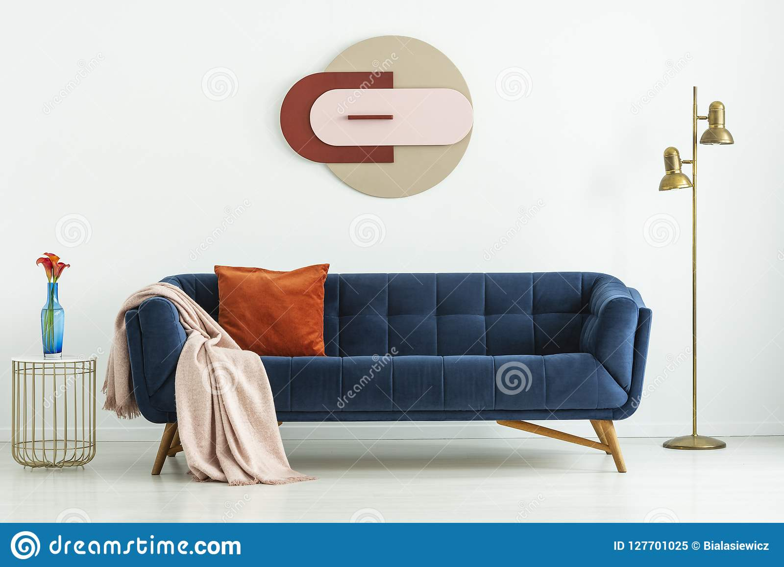 Enjoyable Blue Sofa With Cozy Textiles Between A Golden Floor Lamp And Forskolin Free Trial Chair Design Images Forskolin Free Trialorg