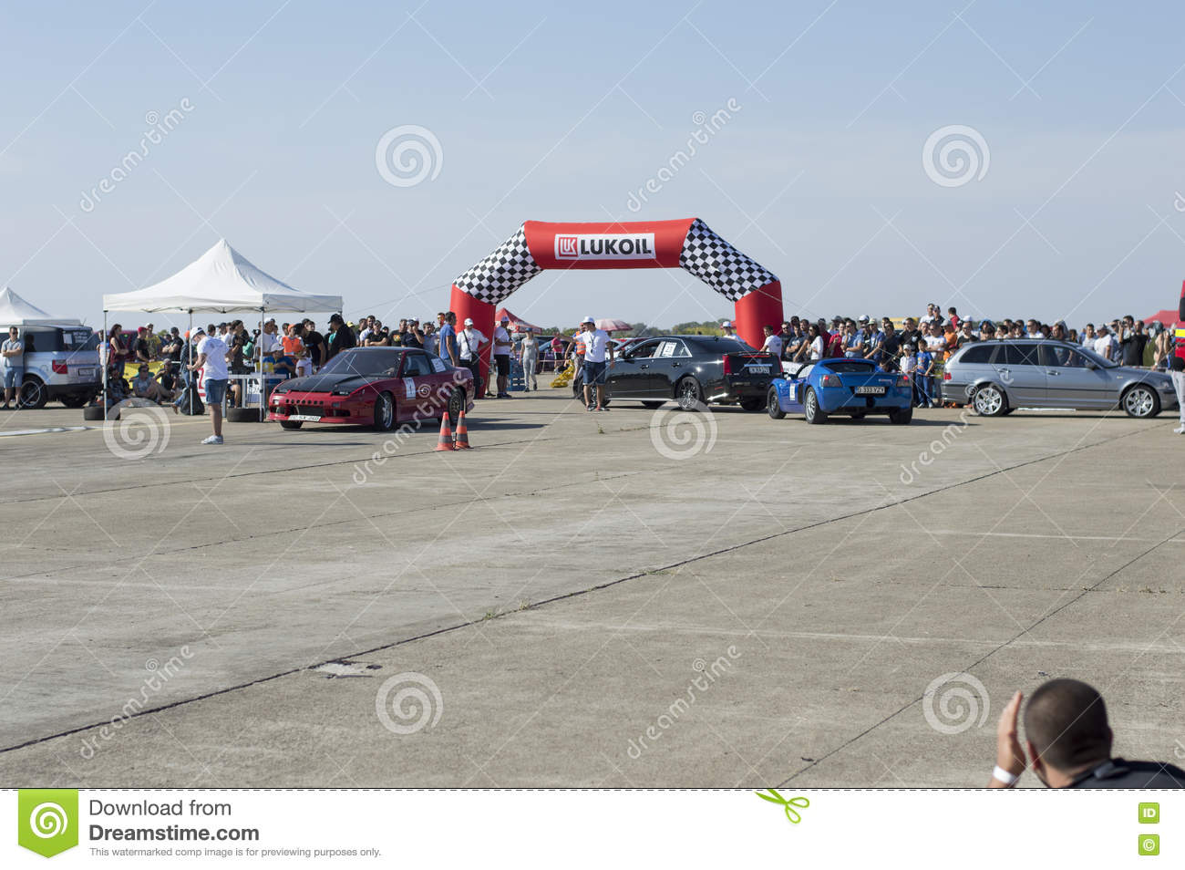 The Blue Sports Car Moves Down From The Race Circuit On