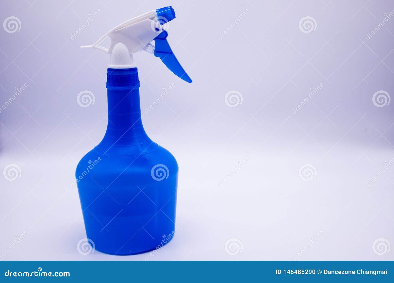 Blue spray bottle on white background
