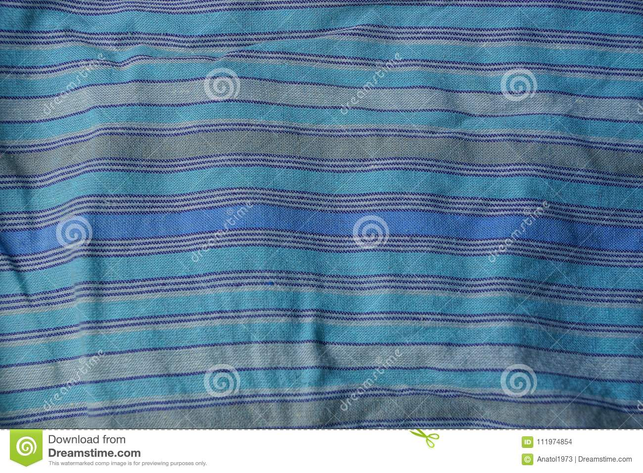 Blue striped texture of a cloth from a piece of crumpled clothes