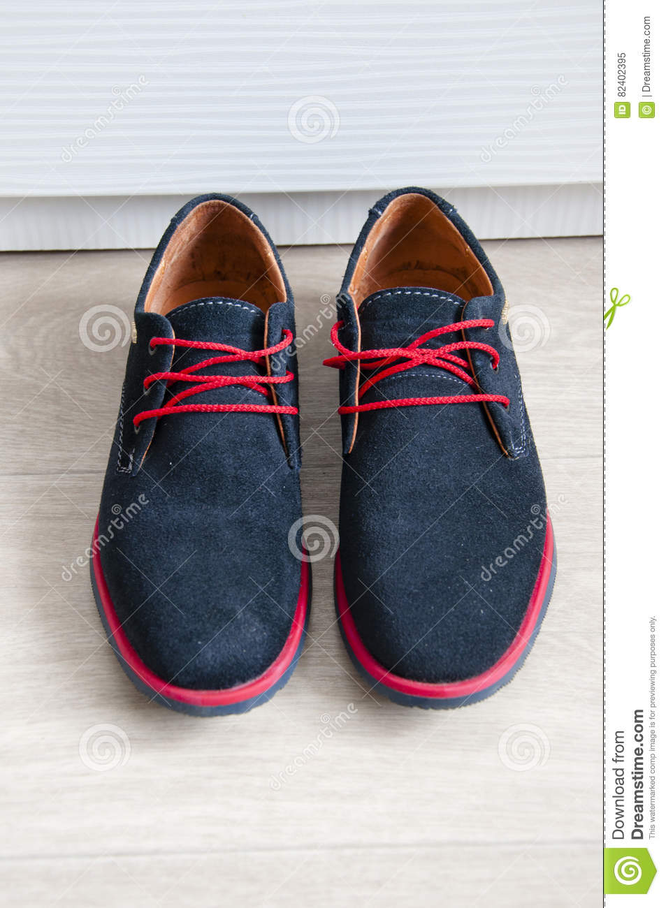 Blue Suede Shoes With Red Laces Stock