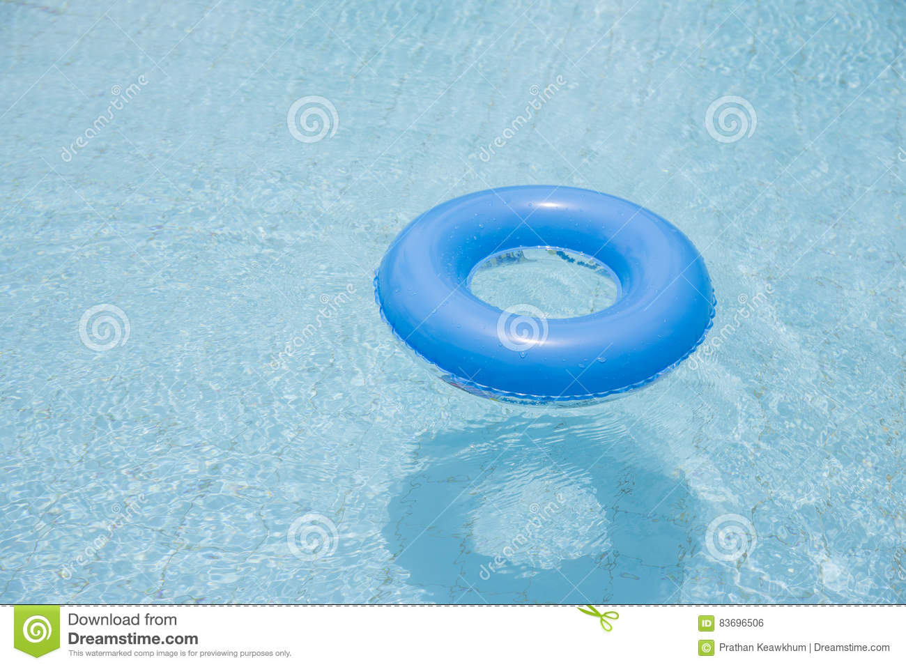 blue swim ring float on swimming pool isolated