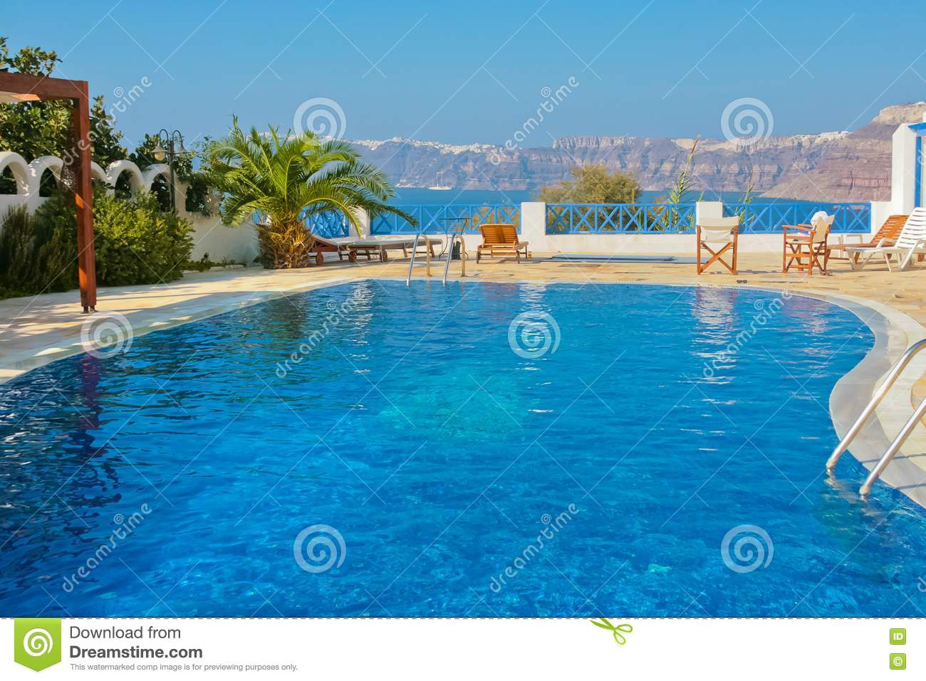 Blue swimming pool in fira on island of santorini stock photography image 19432062 for Private swimming pools long island