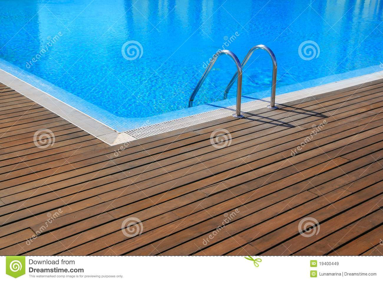 Blue swimming pool with teak wood flooring stock image for Pool time pools