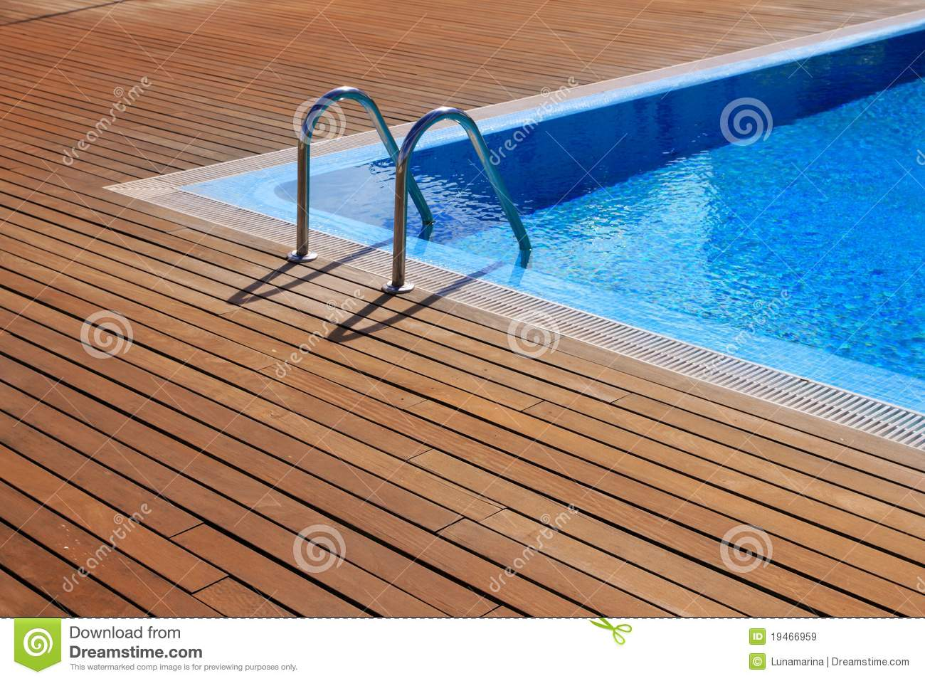 Blue swimming pool with teak wood flooring stock image for Swimming pool floor