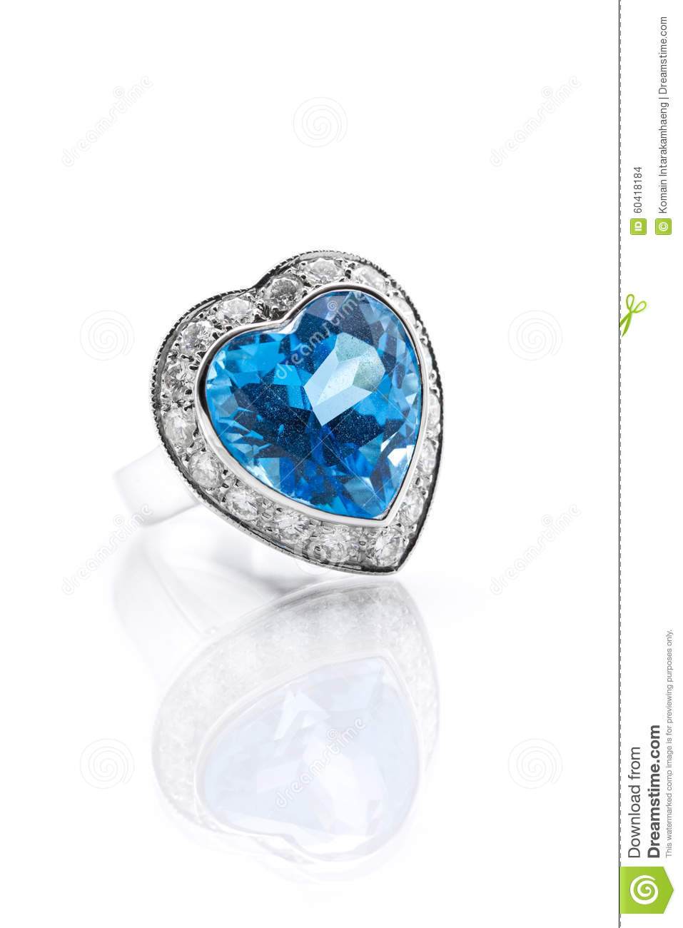 Blue topaz surrounded with diamond ring