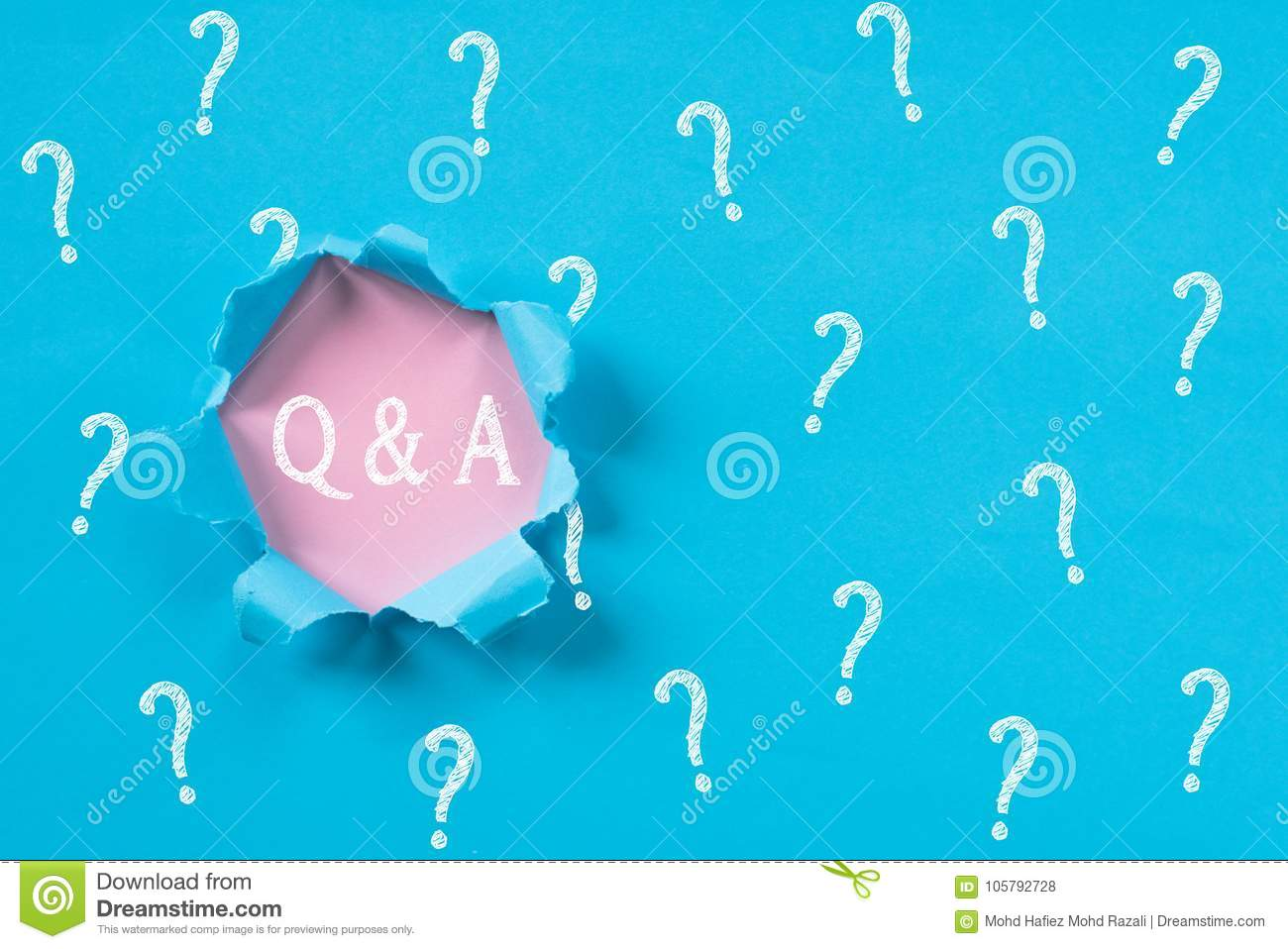 Blue torn paper with question mark revealing Q&A word