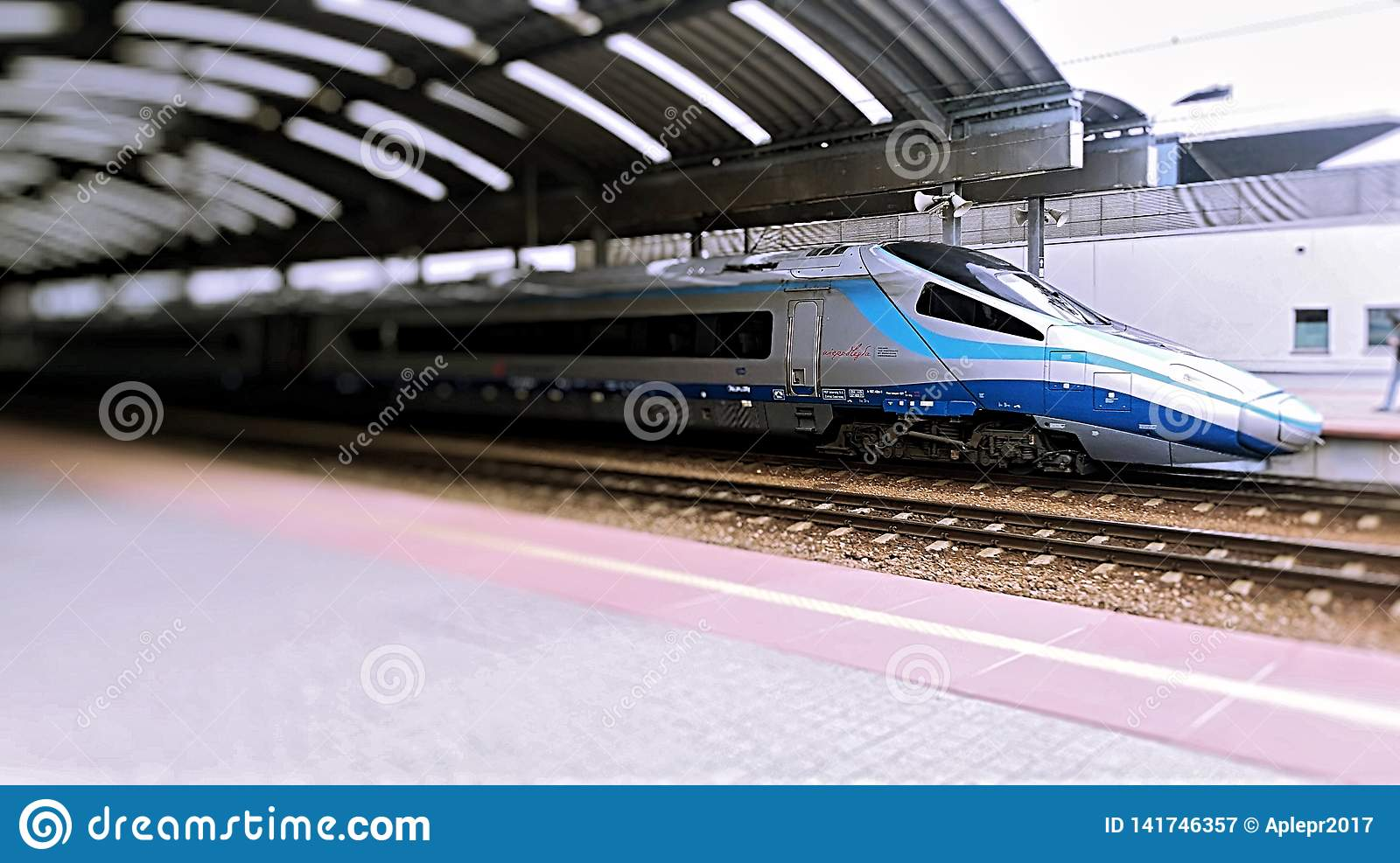 blue train high speed train at the station