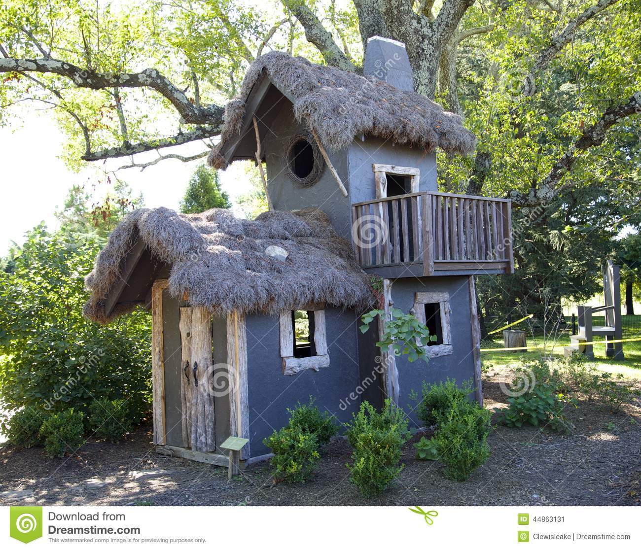 Treehouse with a grass roof stock photo image 44863131 for How to build a treehouse roof