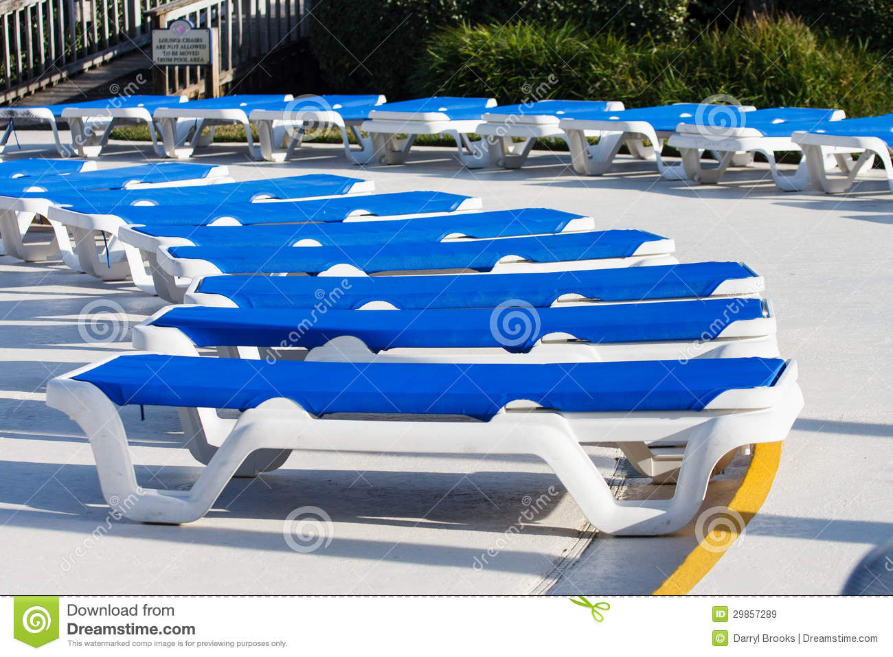 Arc of blue vinyl chaise lounges around pool royalty free stock images image 29857289 - Arc swimming pool ...