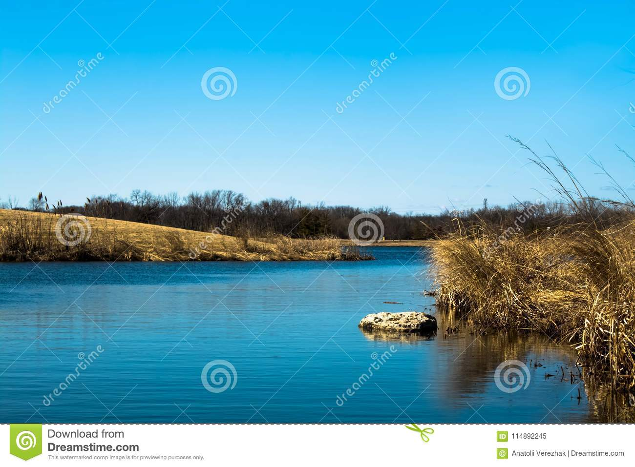 Blue water creek in a sunny but cold day