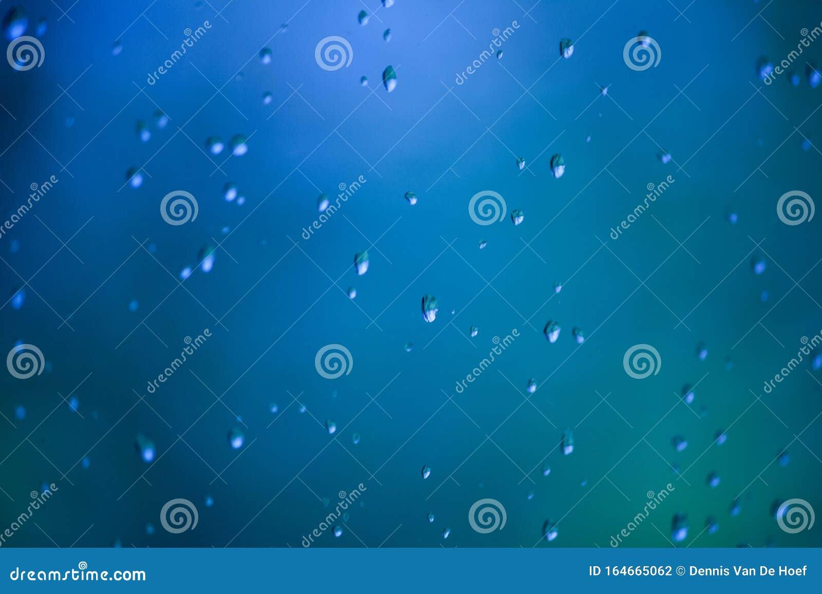 Blue water drops on a window.
