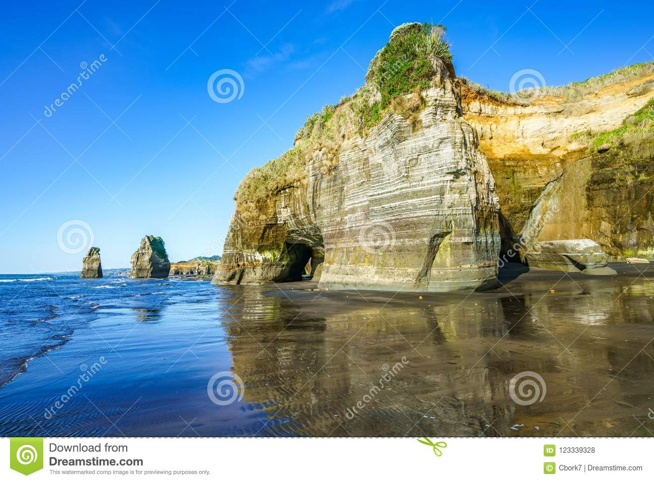 on the beach 3 sisters and elephant rock new zealand 15 stock