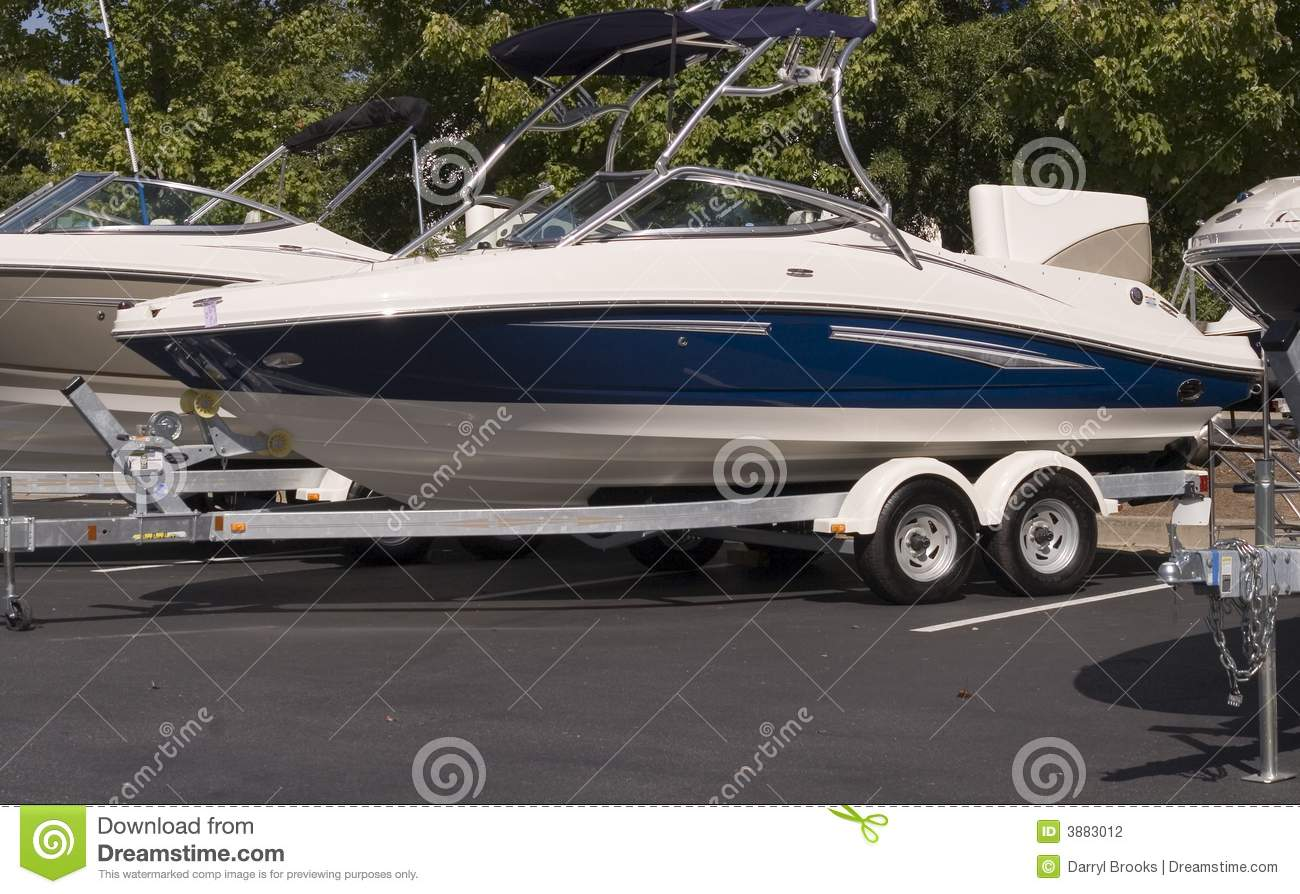 Blue and White Boat on Trailer