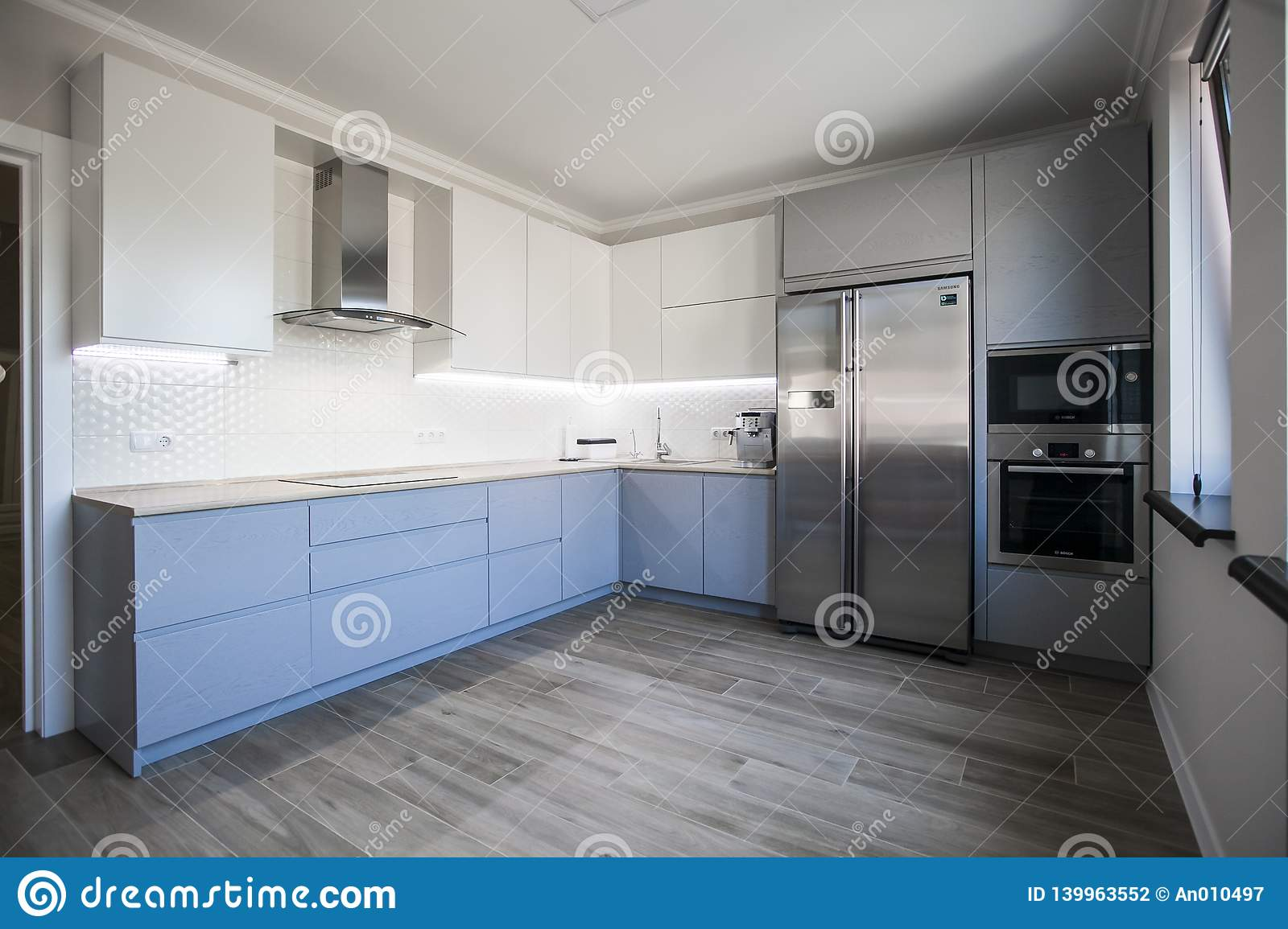 Blue and White Cabinets in Modern Kitchen Interior Stock Photo ...