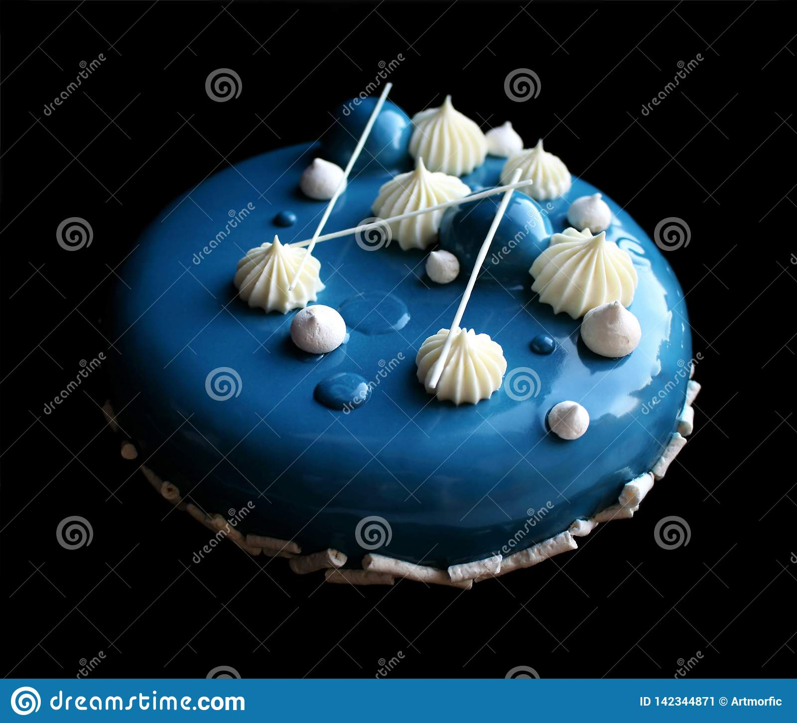 Blue and white cake with white shiny mousse cake with mirror glaze, meringues and ganache