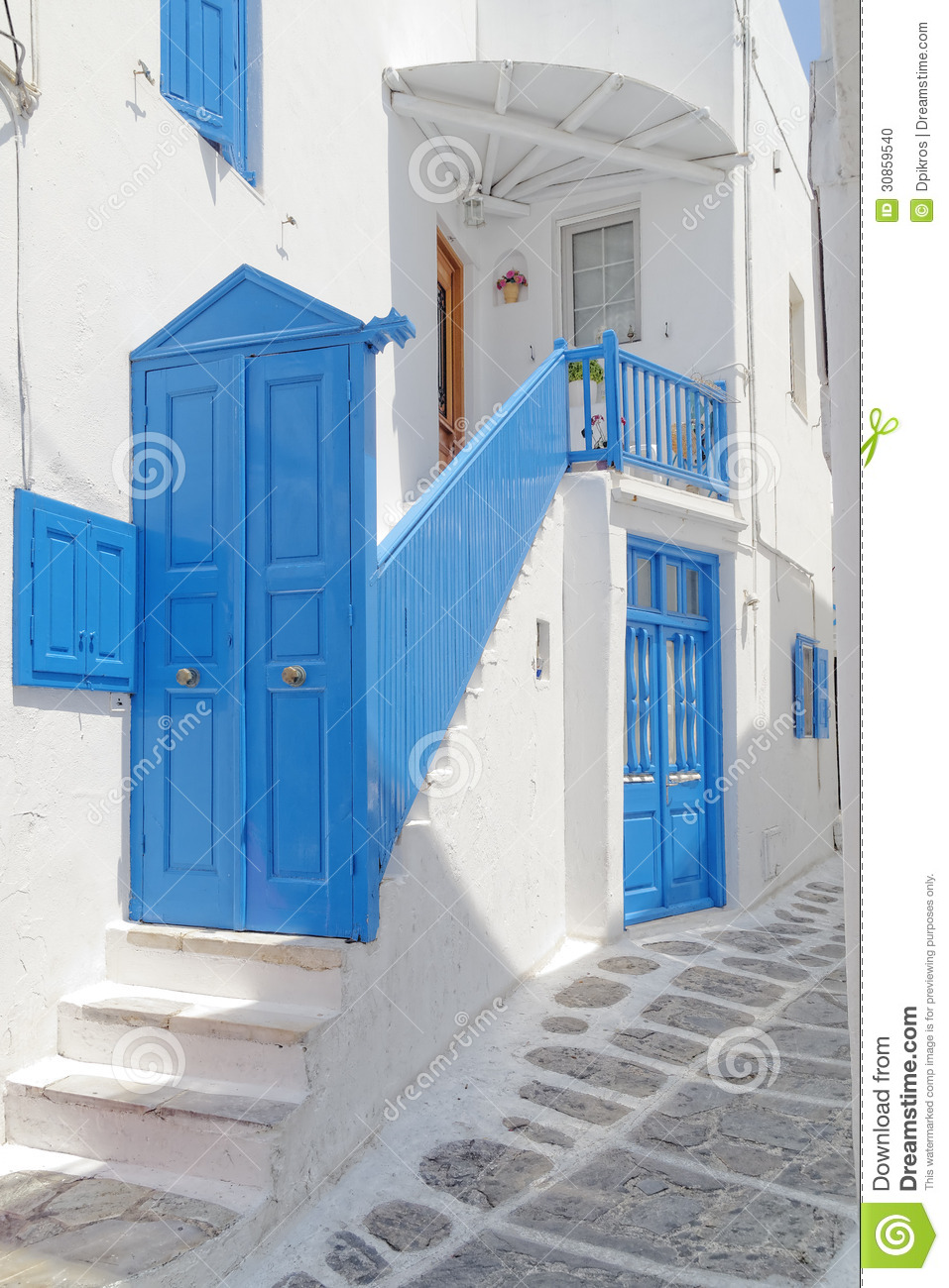 Blue white house entrance mikonos island stock photo for Blue and white house