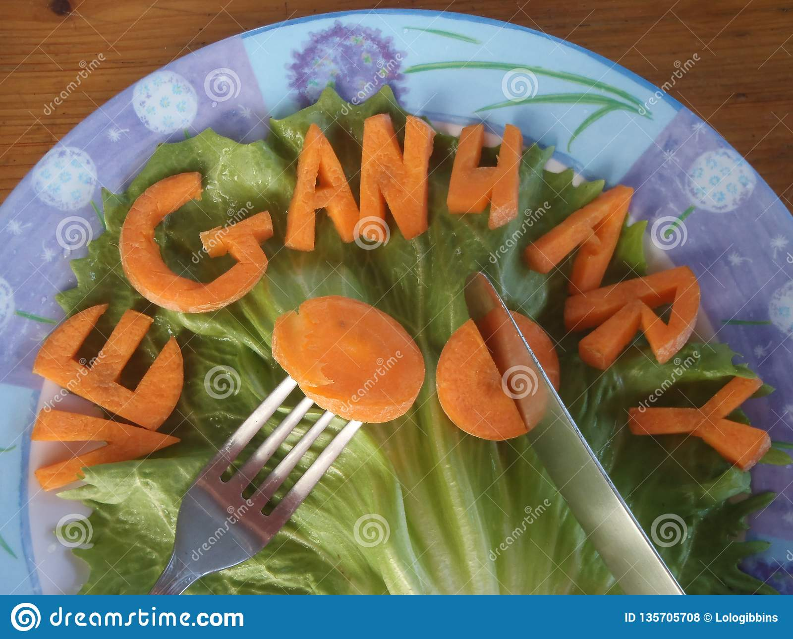 A blue and white plate of carrot spelling veganuary