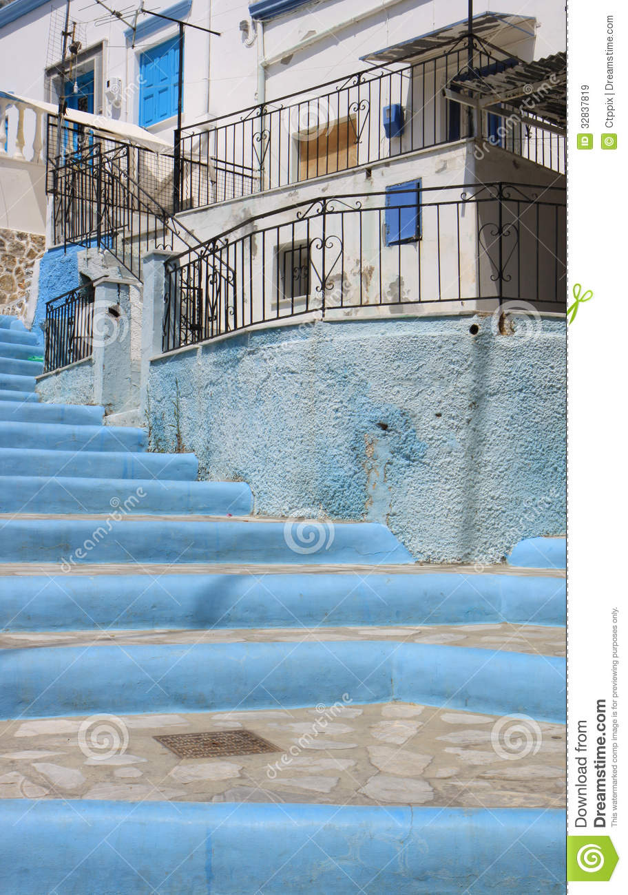 Blue and white steps to a traditional white and blue greek for Blue and white house