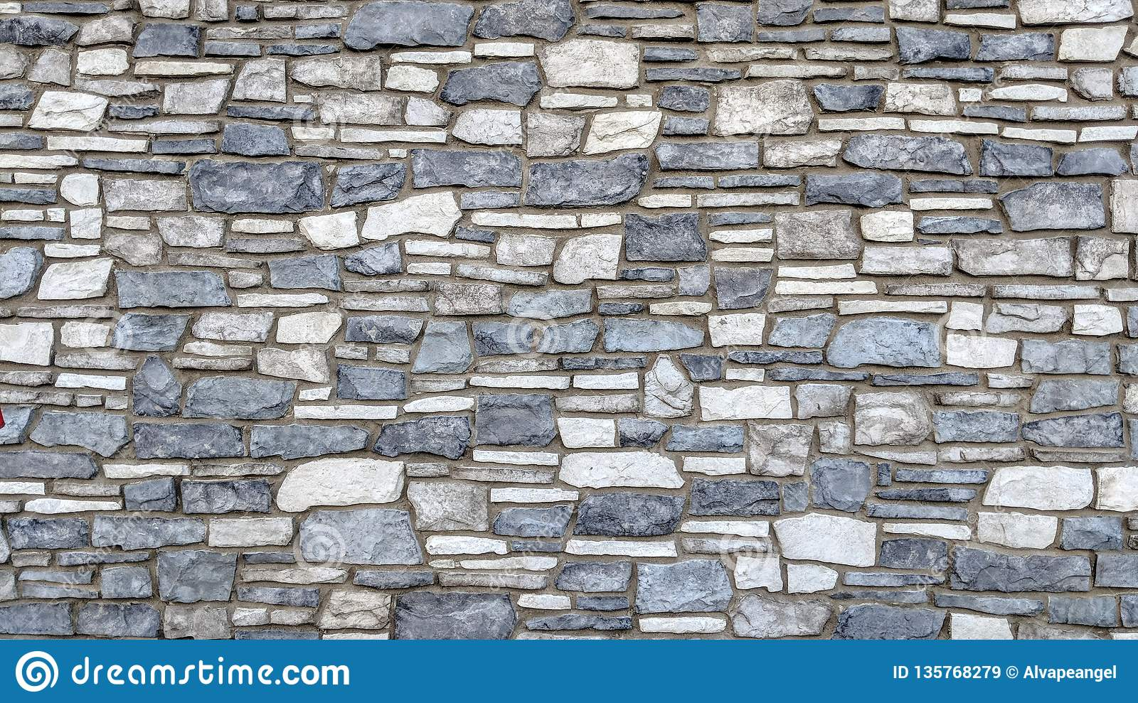 Blue and white stone wall