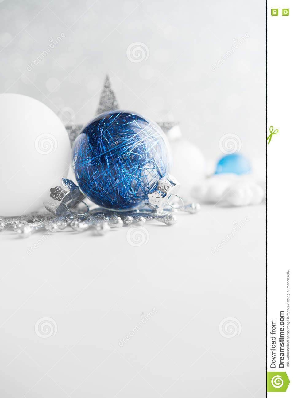 Blue And White Xmas Ornaments On Glitter Holiday