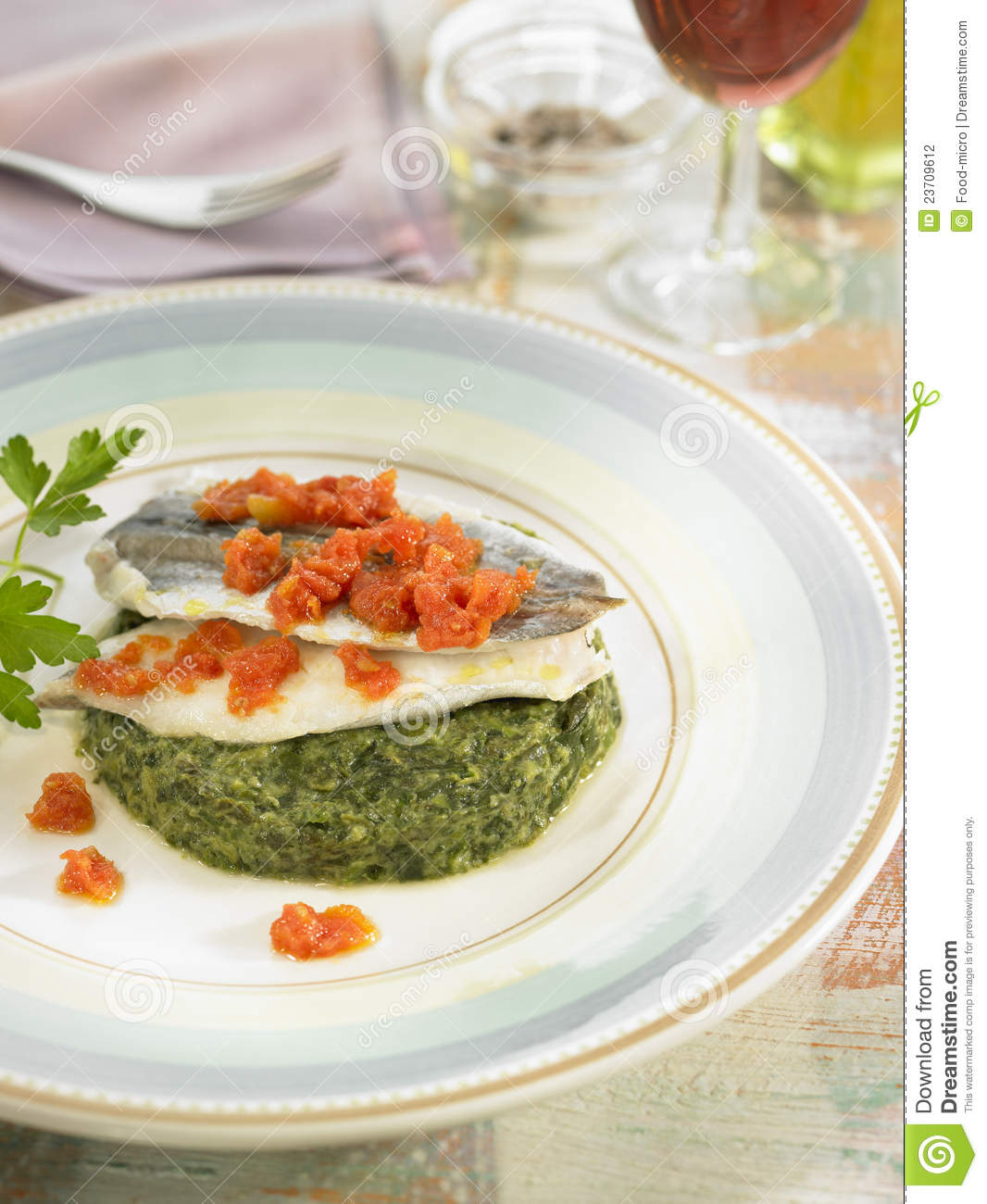 Blue whiting fillets with spinach and tomatoes,Food, gastronomy ...