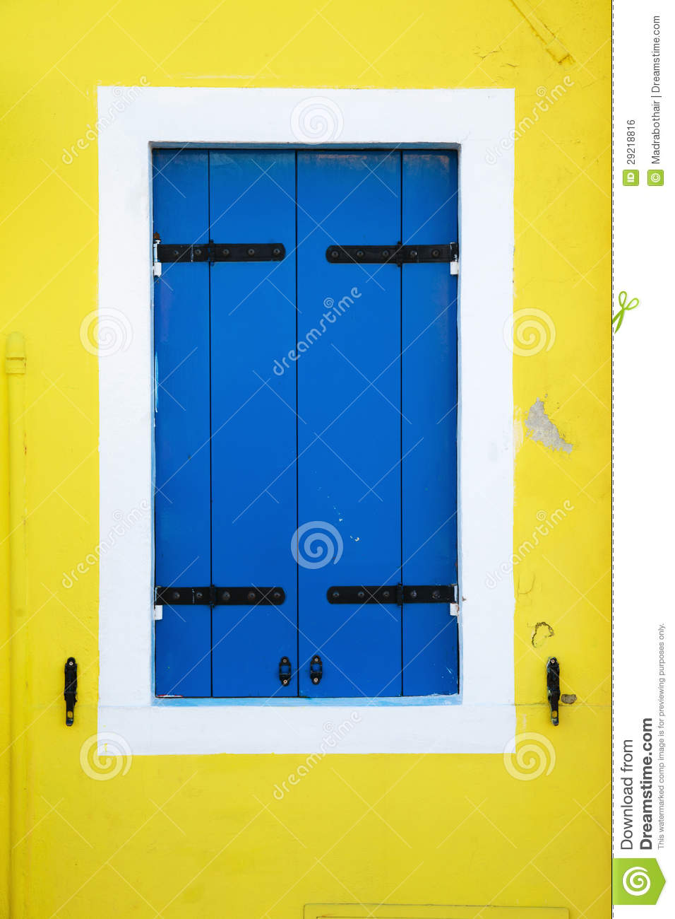 Blue Window Shutters On A Yellow House Wall Royalty Free Stock ...