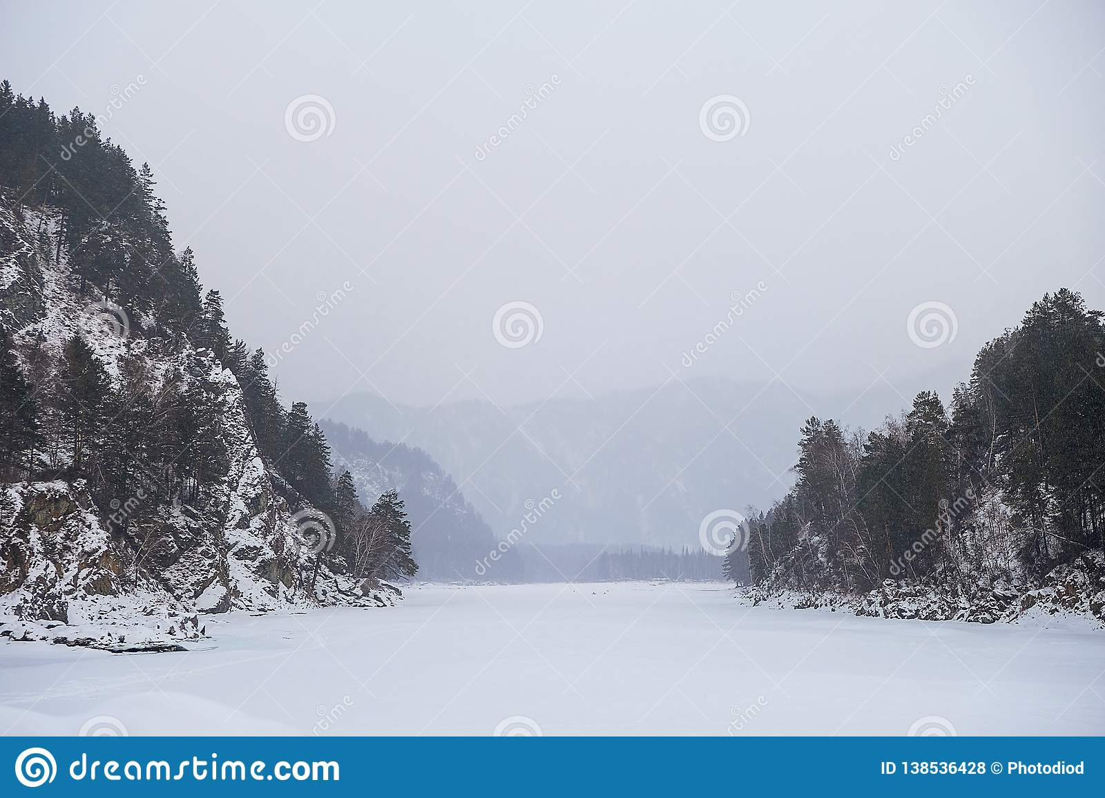 Blue winter mountain misty river. Snow frozen pine trees Idyllic landscape. Winter mountains natural view, sky, forest . Travel