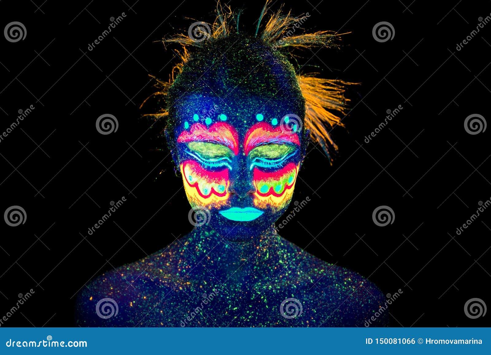 Blue woman portrait, aliens sleeps, ultraviolet make-up. Beautiful on a dark background.
