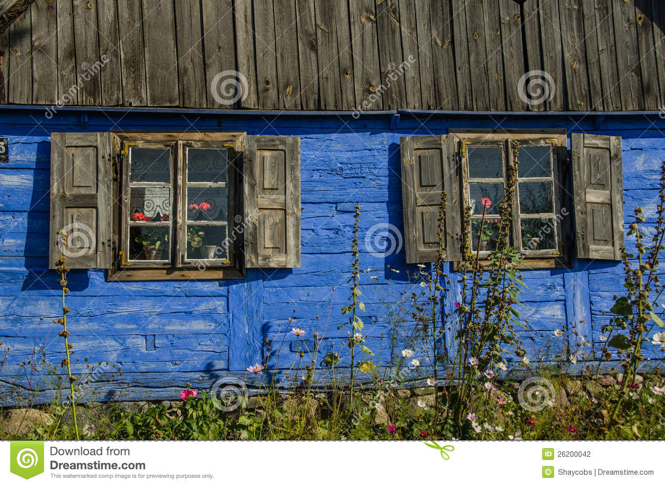 Blue wooden outer wall of a country house with two stock for House outer wall design