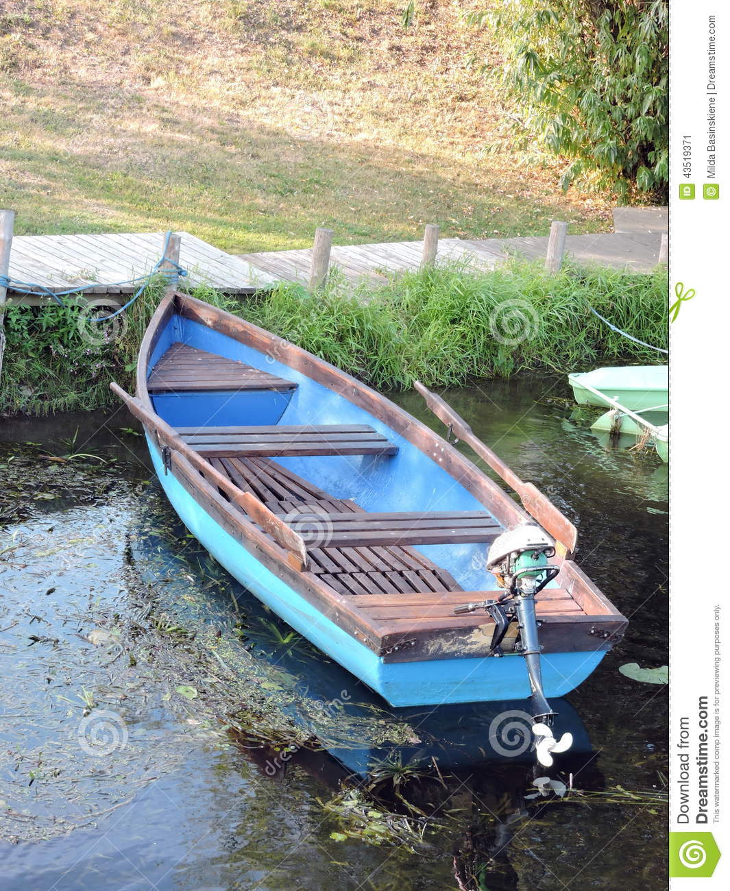 Blue wooden rowboat stock image. Image of grass, green ...