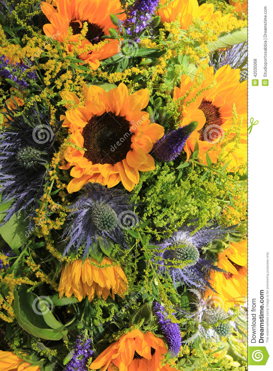 Blue And Yellow Sunflower Arrangement Wedding Decorations Stock