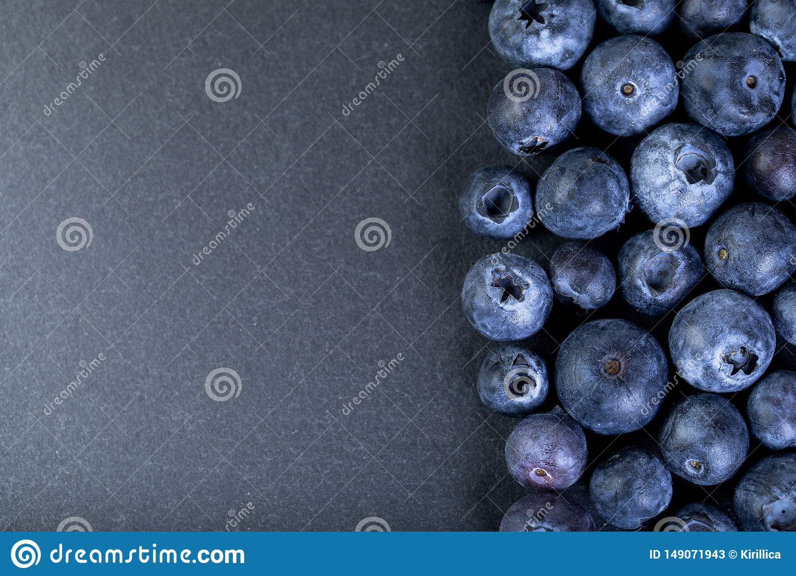 Blueberries on black stone board