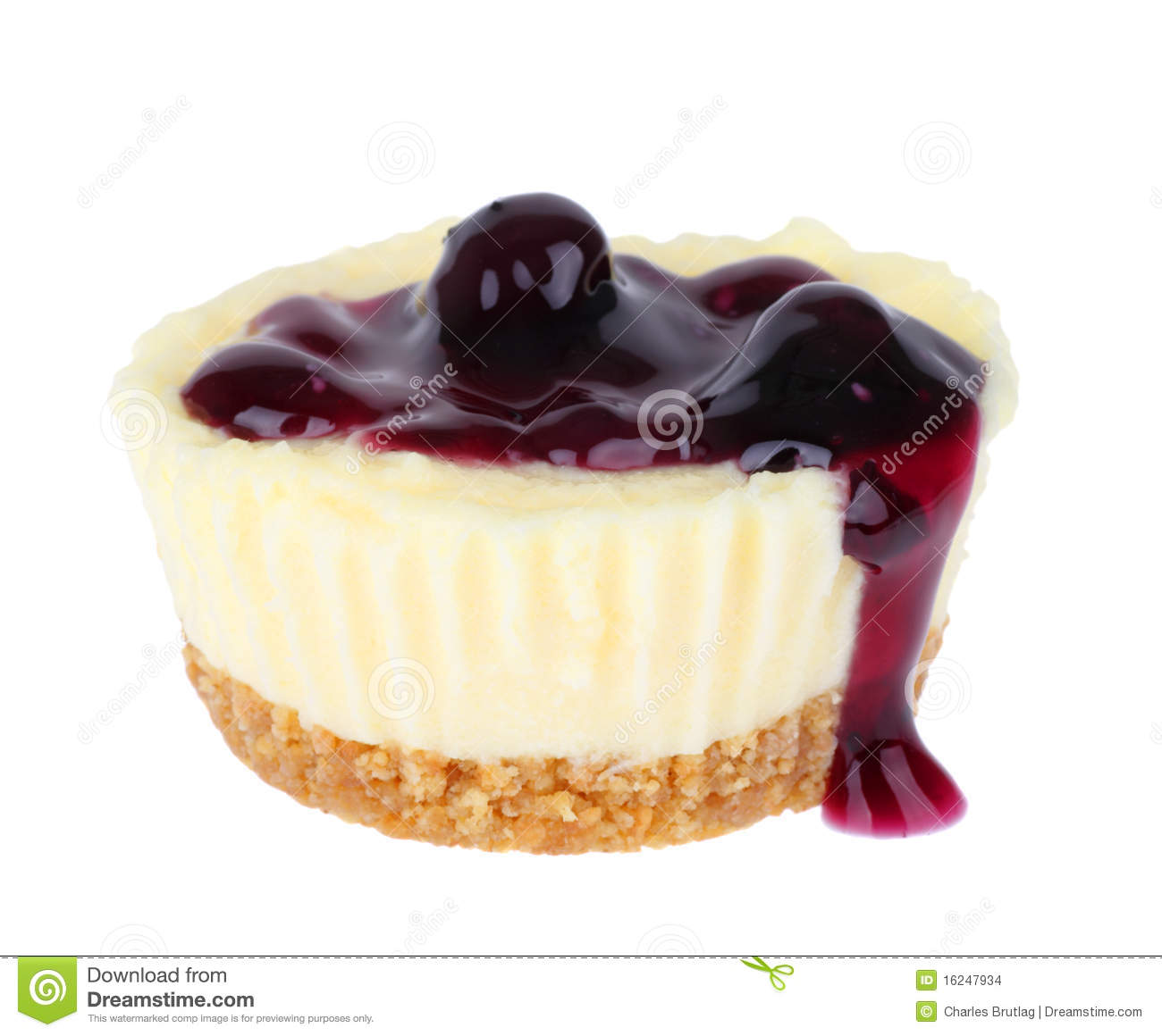 Cheesecake cupcake topped with blueberries isolated on white.