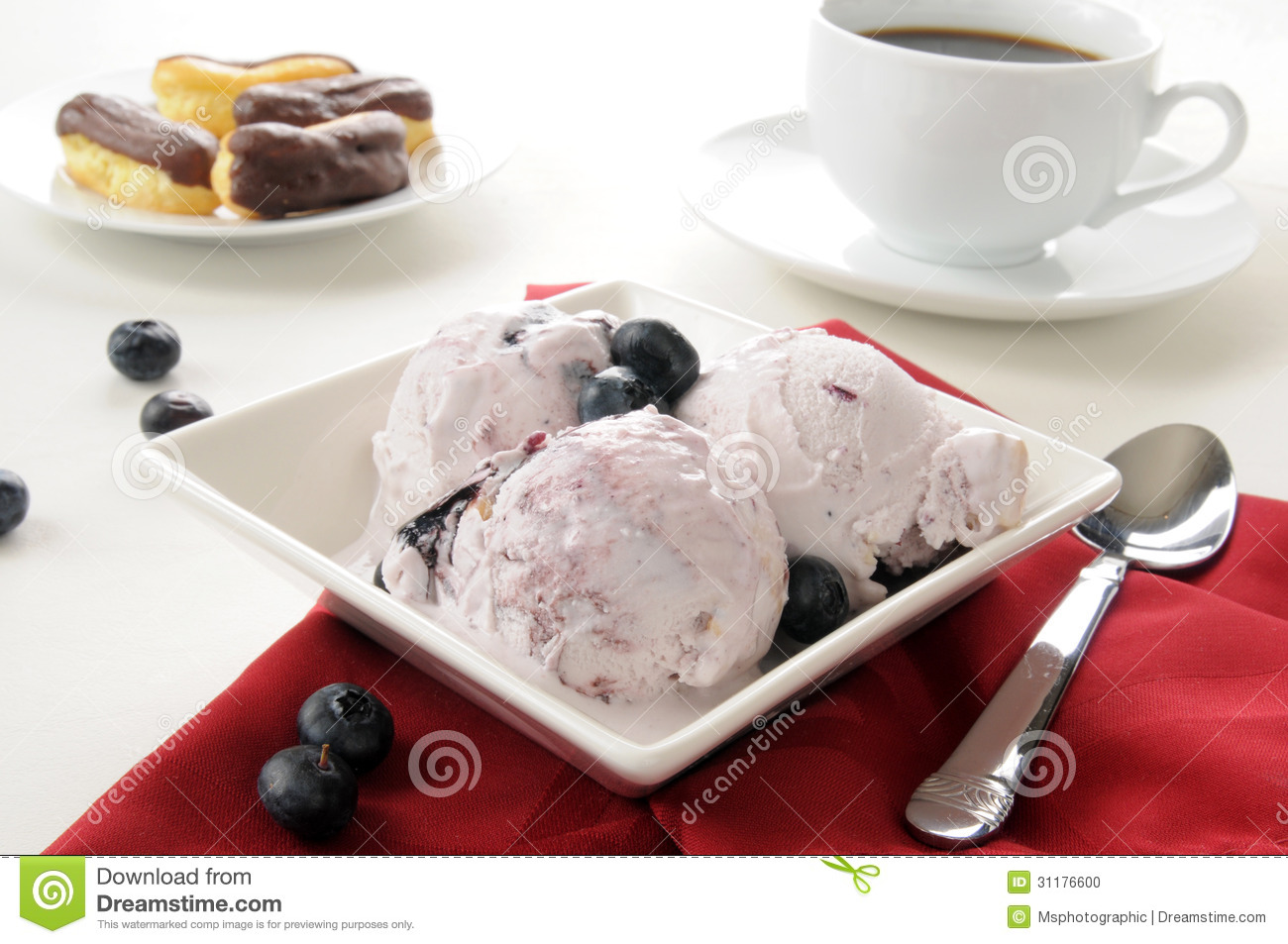 Blueberry cheesecake ice cream with coffee and eclairs.