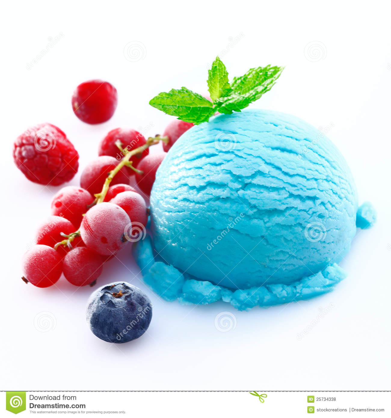 Scoop of blueberry icecream with chilled redcurrants, raspberries and ...