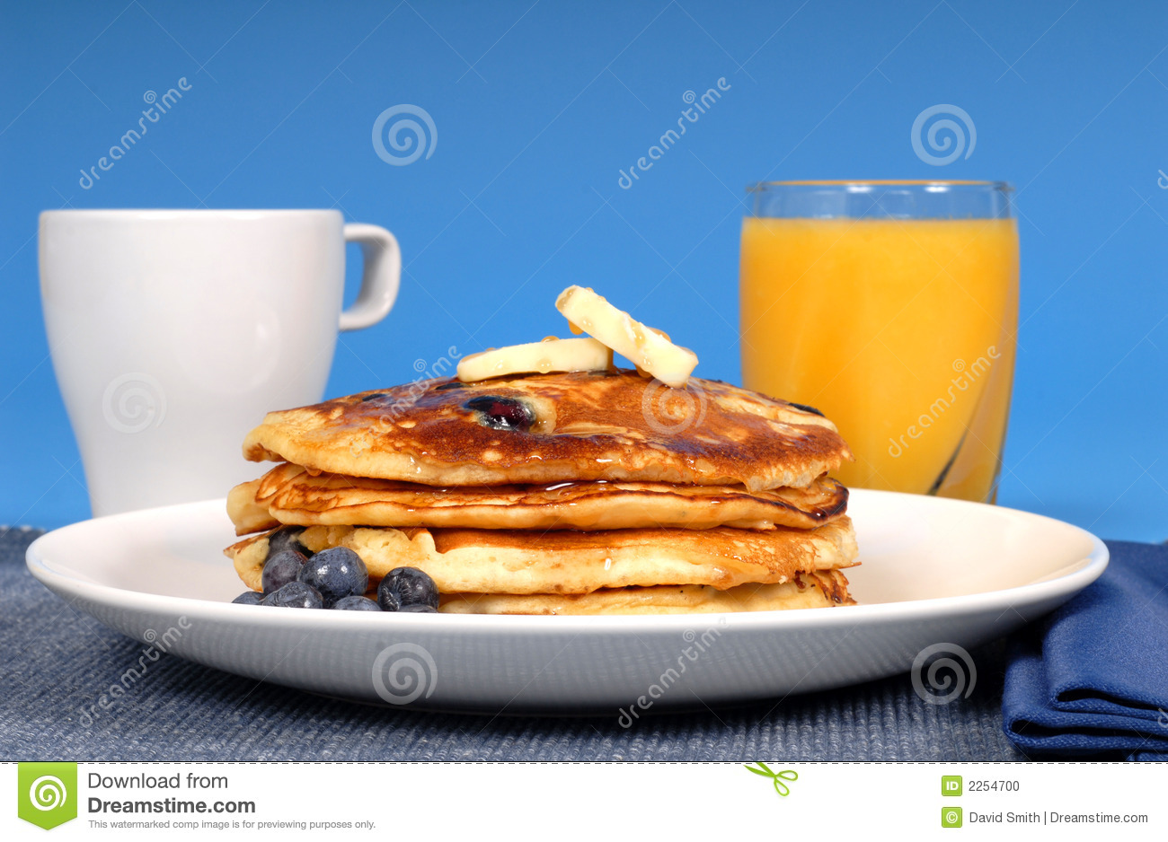 Blueberry pancakes with juice