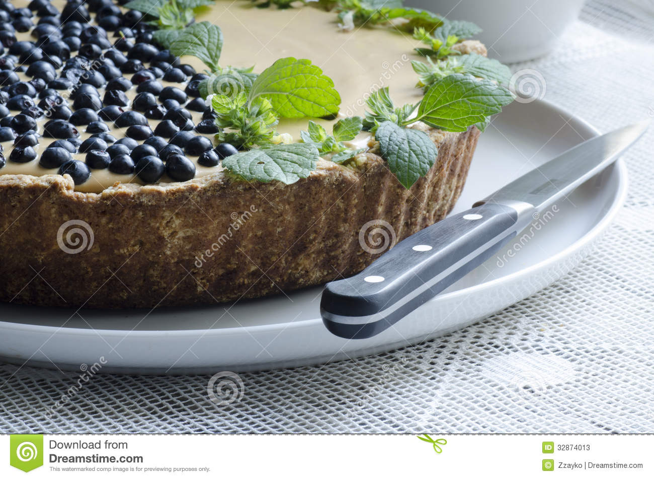 Blueberry pie with mint served with knife