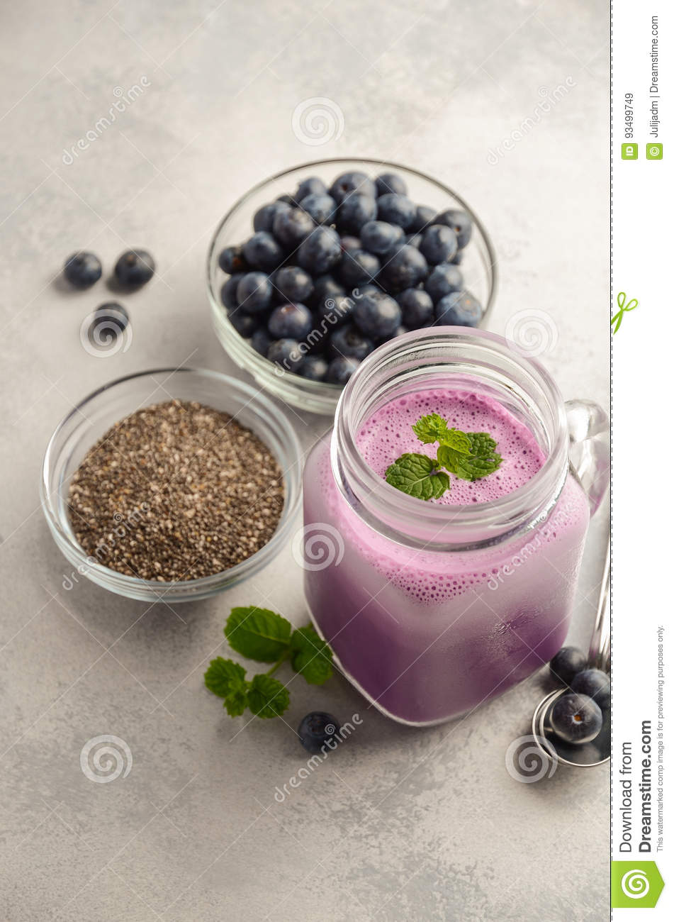 Blueberry smoothie with chia seeds in glass jar on grey concrete background