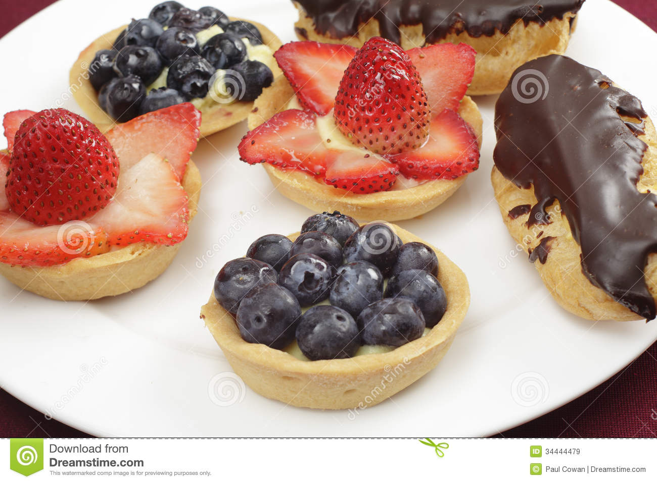 ... topped with fresh strawberries or blueberries, and chocolate eclairs