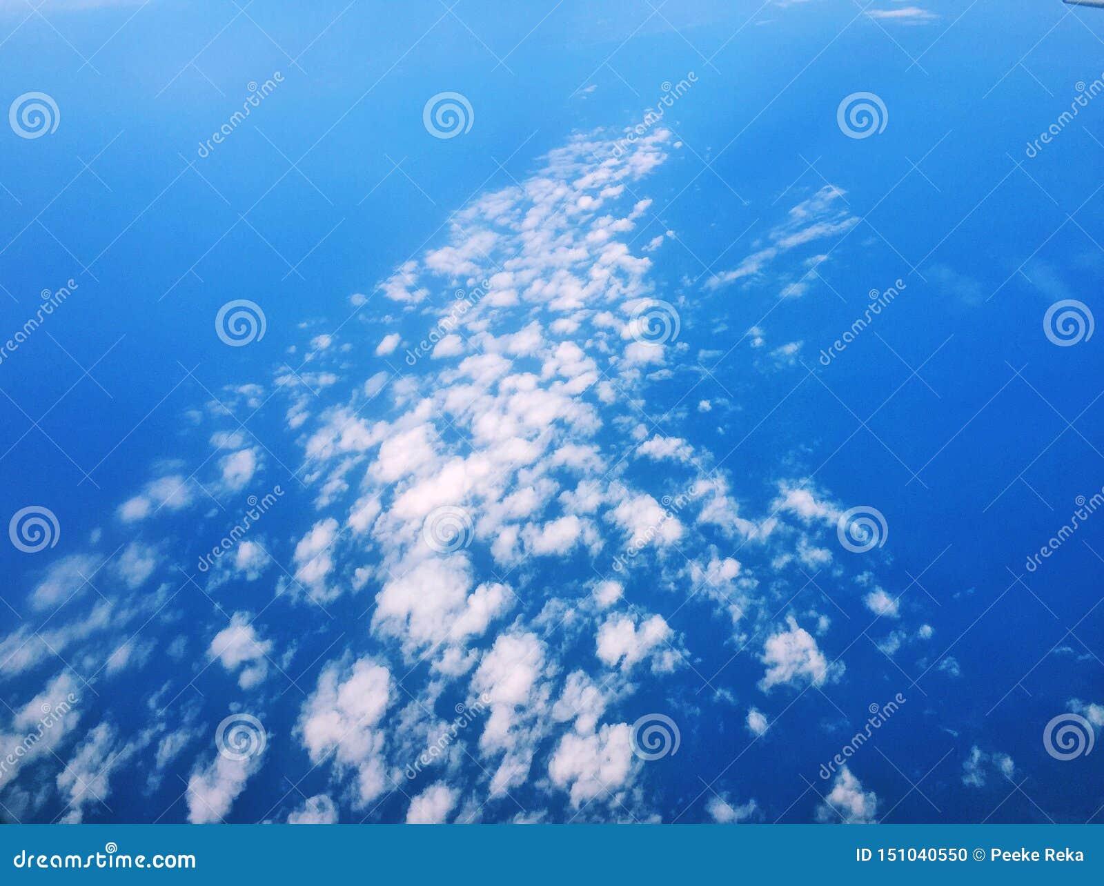 Bluen clouds skywhite