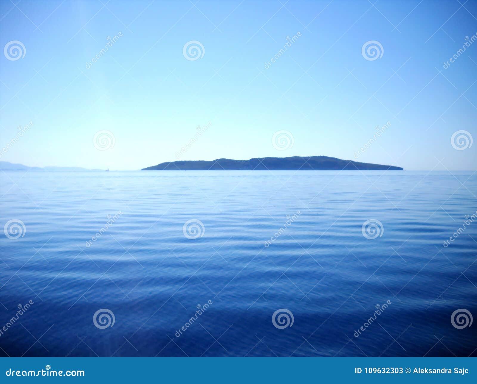 Blueness morze, niebo i Ionian wyspa,