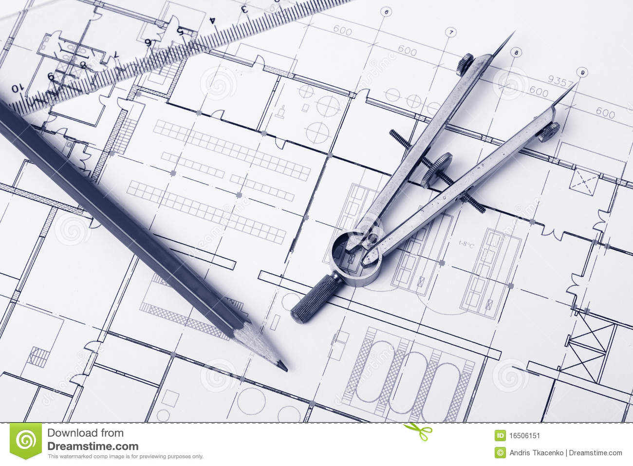 Pencil and divider on top of a floor plan tinted photo