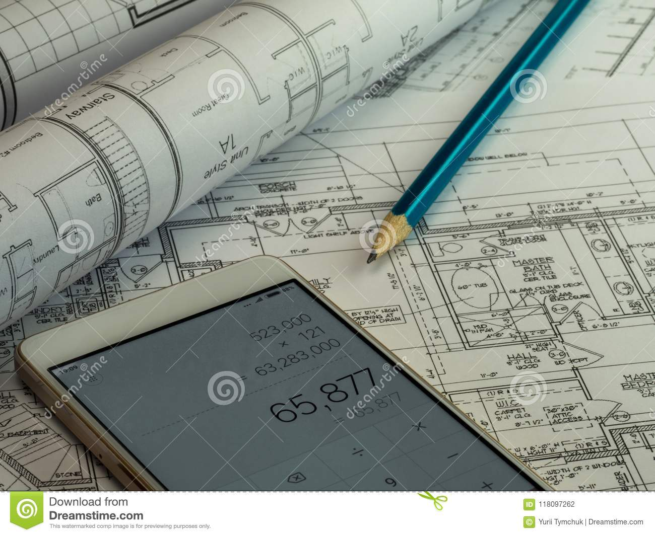 Blueprint plan of house building construction with pencil and ca