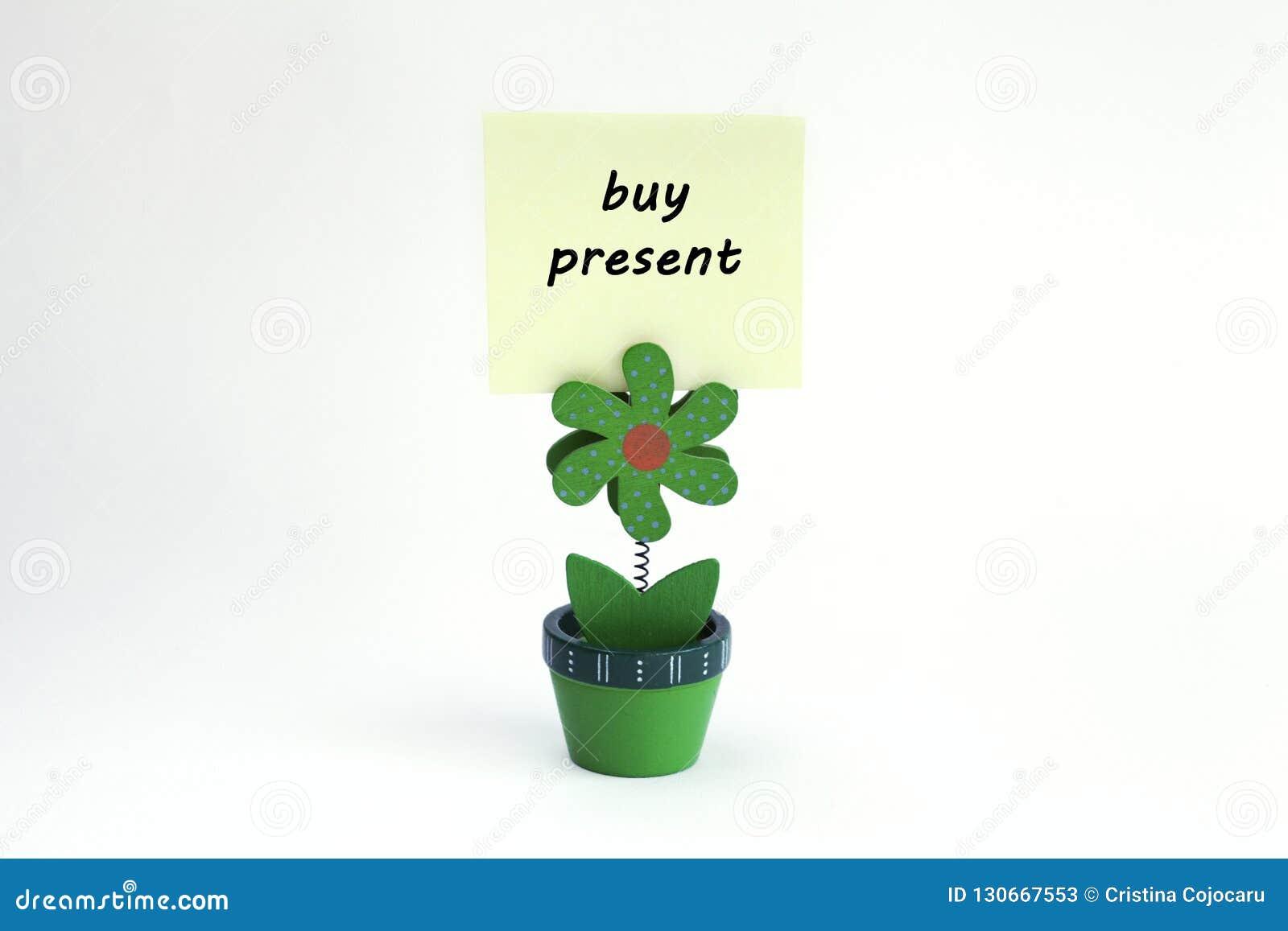Blumenfotoclip mit der Kaufgeschenkmitteilung geschrieben auf Post-It