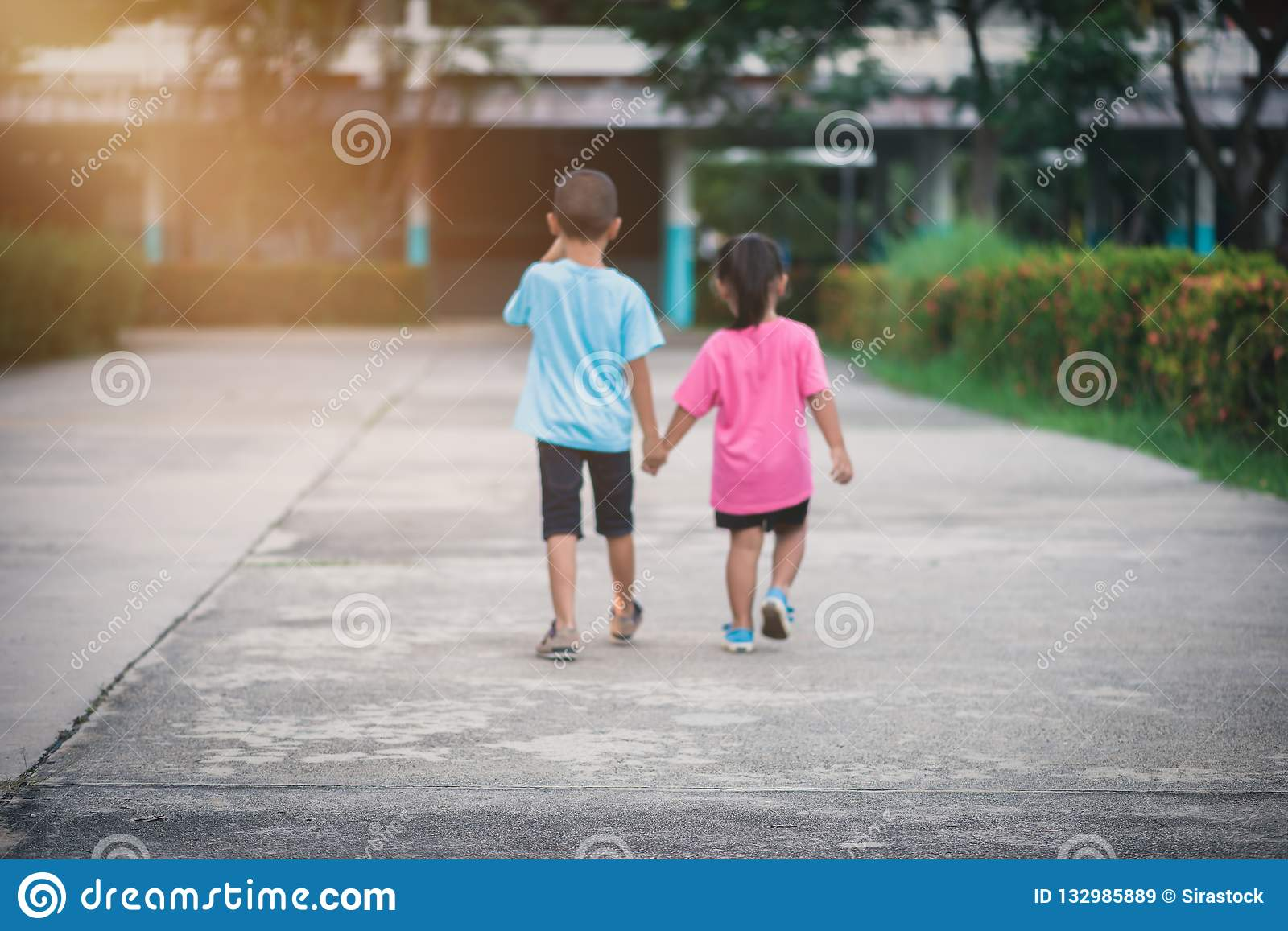Blur Background Brothers And Sisters Walk Hand In Hand Stock Image