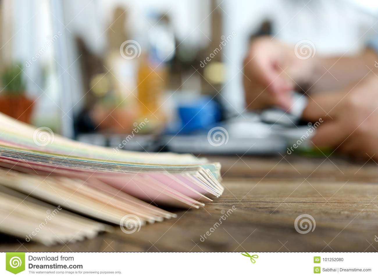 blur graphic designer working with computer and color tone paper