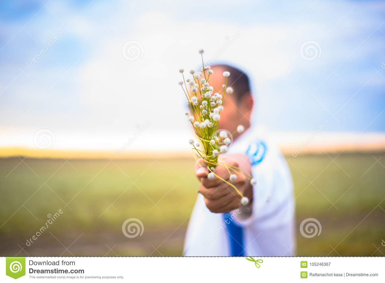 Blur People Is Holding Abeautiful Bouquet Of Autumn Grass Flowe