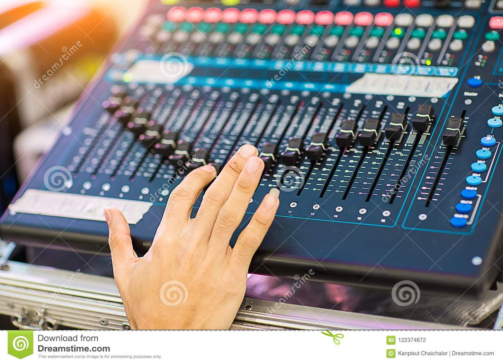 Blur Photo Hand Adjusting Audio Mixer  Sound Engineer Hands