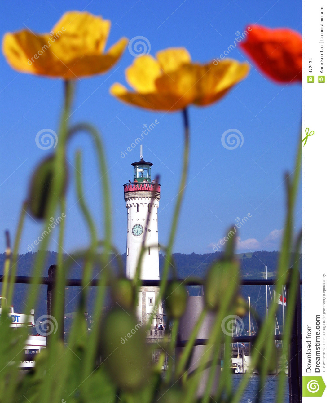 Download Blure Poppies With The Lighthouse Stock Photo - Image of lake, blue: 472034